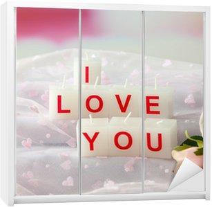 Fotobehang kaarsen met gedrukte teken i love you op lichte kaststicker kaarsen met gedrukte teken i love you op lichte achtergrond voltagebd Images