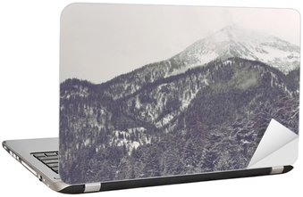 Clouds moving over distant mountain peak Laptop Sticker