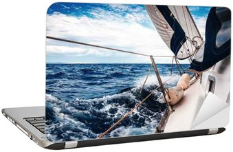 The white sails of yachts on the background of sea and sky in the clouds Laptop Sticker