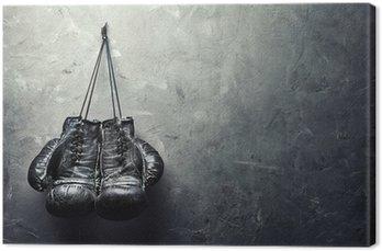 Leinwandbild Alte Boxhandschuhe hängen Nagel auf wand