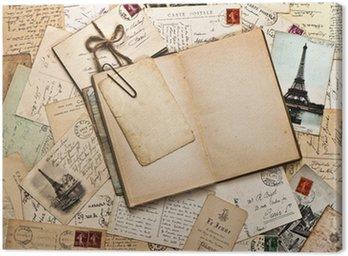 Leinwandbild Alte Papiere, französisch Postkarten und offene Tagebuch Buch