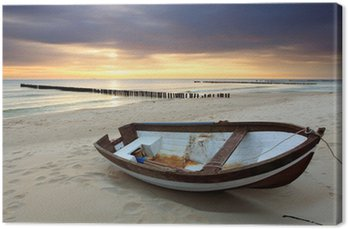 Leinwandbild Boot am schönen Strand in sunrise