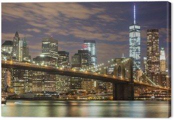 Leinwandbild Brooklyn Bridge und Downtown Wolkenkratzer in New York in der Abenddämmerung