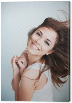 Leinwandbild Das junge Mädchen, das glücklich lacht