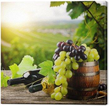 Leinwandbild Flaschen Rot-und Weißwein mit frischen Weintrauben