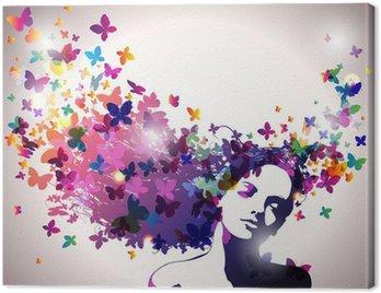 Leinwandbild Frau mit einem Schmetterling im Haar.