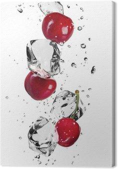 Leinwandbild Frische Kirschen mit Eiswürfeln, isoliert auf weißem Hintergrund