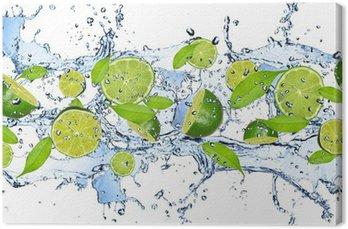 Leinwandbild Frische Limetten im Wasser spritzen, isoliert auf weißem Hintergrund