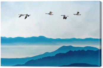 Leinwandbild Gänse fliegen gegen den blauen Himmel im Hintergrund