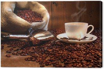 Leinwandbild Kaffeetasse mit Sack von gerösteten Bohnen