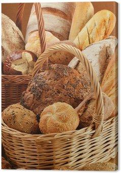 Leinwandbild Komposition mit Brot und Brötchen in Weidenkörbe