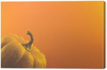 Leinwandbild Kürbis auf orange Hintergrund