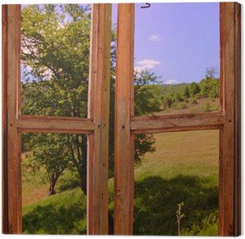 Leinwandbild Landschaft durch ein Fenster gesehen