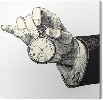 Leinwandbild Man Hand mit einer Uhr