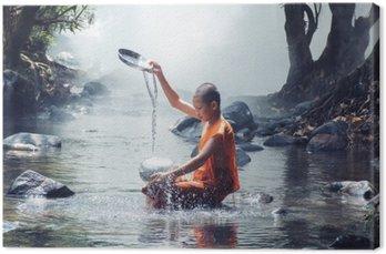 Leinwandbild Mönch spielen Wasser