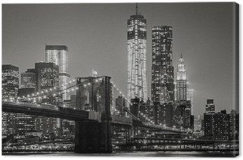 Leinwandbild New York bei Nacht. Brooklyn Bridge, Lower Manhattan - Schwarz ein