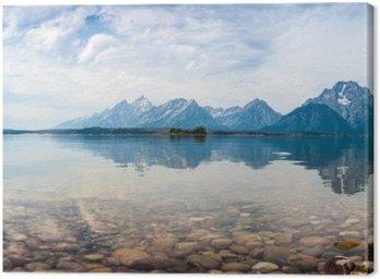 Leinwandbild Reflektierte Bergspitzen auf einem See