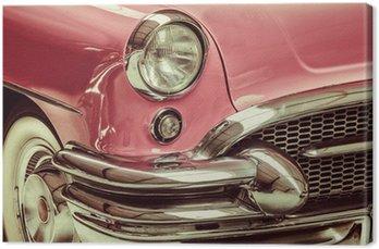 Leinwandbild Retro Stil Bild eines vor einem klassischen Auto