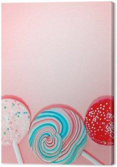 Leinwandbild Rosa Hintergrund mit farbigen Süßigkeit