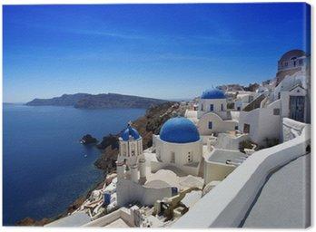 Leinwandbild Santorini mit traditionellen Kirchen in Oia, Griechenland