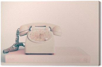 Leinwandbild Weinlese-rosa Telefon über Bücher