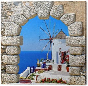 Leinwandbild Windmill durch ein altes Fenster auf der Insel Santorini, Griechenland