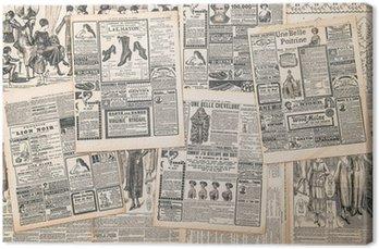 Leinwandbild Zeitungsseiten mit antiken Werbung