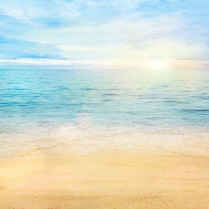 Morze i piasek w tle