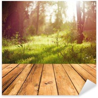 Naklejka Drewniana podłoga tarasu na tle lasu