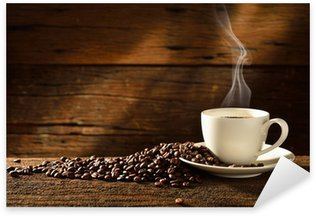 Naklejka Filiżanka kawy i ziarna kawy na starym drewnianym tle
