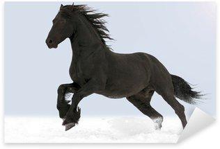 Naklejka Pixerstick Koń galopuje przez śnieg
