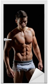 Naklejka na Drzwi Muscular młody chłopak nago sexy stwarzających w bielizna