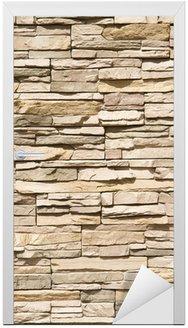 Naklejka na Drzwi Ułożone pionowo tle ściany z kamienia