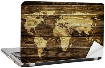 Naklejka na Laptopa Mapa świata na tle drewna