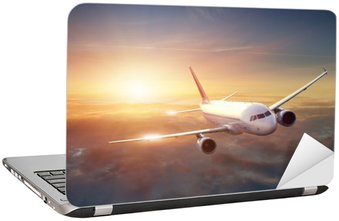 Naklejka na Laptopa Samolot na niebie o zachodzie słońca