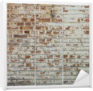 Naklejka na Szafę Tło starego rocznika brudne ściany z cegły z peelingiem gipsu