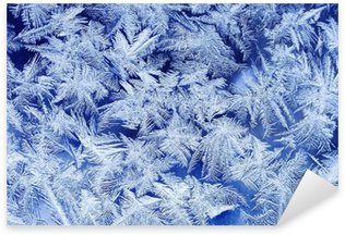 Naklejka Pixerstick Piękna świąteczna mroźny wzór z Białe płatki śniegu na niebieskim tle na szkle