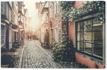 Obraz na Plátně Historické ulice v Evropě, při západu slunce s retro vintage efektem