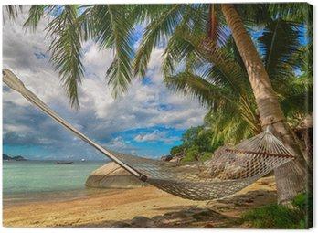 Obraz na Plátně Houpací síť mezi palmami u moře na tropickém ostrově