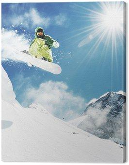 Obraz na Plátně Snowboarder na skok inhigh horách