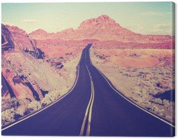Obraz na Plátně Vintage tónovaný zakřivený pouštní dálnice, cestovní koncept, USA