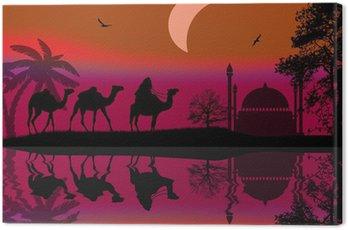 Beduini na wielbłądach w czerwonej nocy