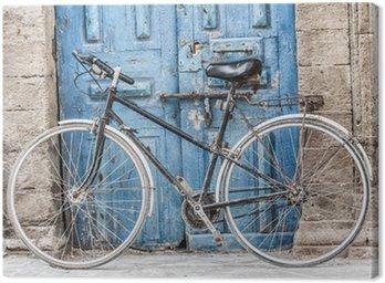 Obraz na Płótnie Biały rower przed sklepem w Marakeszu, Maroko