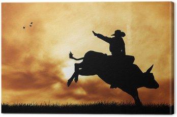 Bull rider o zachodzie słońca