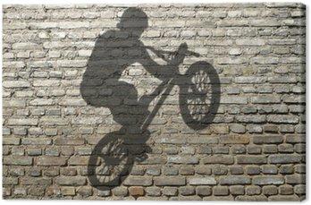 Obraz na Płótnie Cień człowieka w BMX na ceglany mur