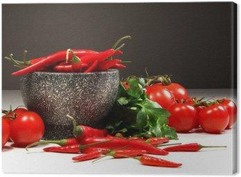 Obraz na Płótnie Czerwona papryka i pomidory w misce na ciemnym granitem