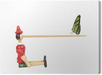 Obraz na Płótnie Drewniana lalka z długimi Pinokio nosa