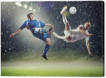 Obraz na Płótnie Dwóch piłkarzy uderzając piłkę