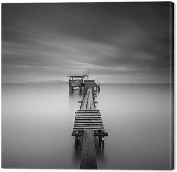 Obraz na Płótnie Dzieła sztuki obraz drewniane molo rybackiego na plaży w czerni i white.Long ekspozycji strzał z motion blur.