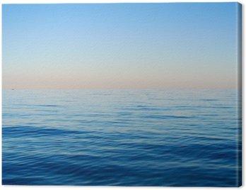 Obraz na Płótnie Fale morskie na tle błękitnego nieba